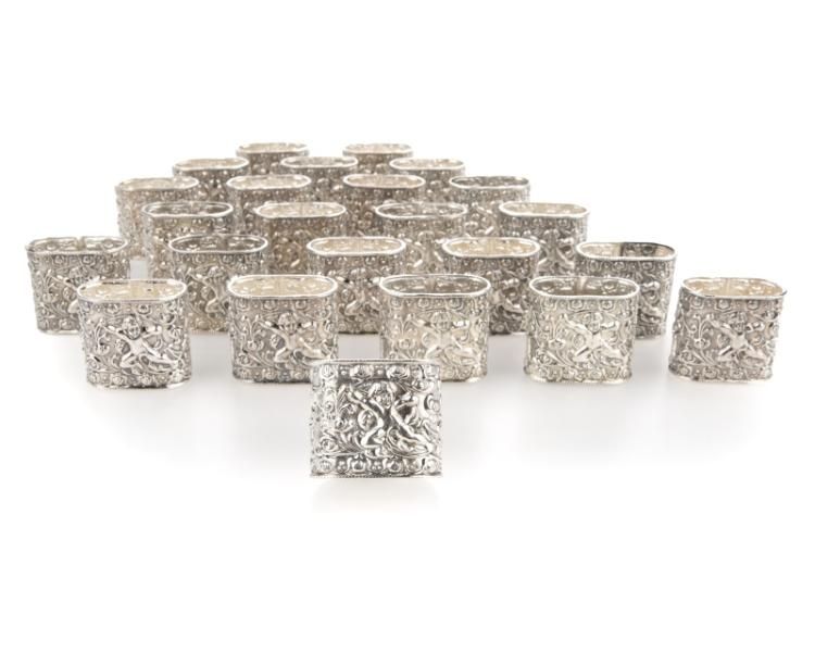 24 sterling silver napkin rings