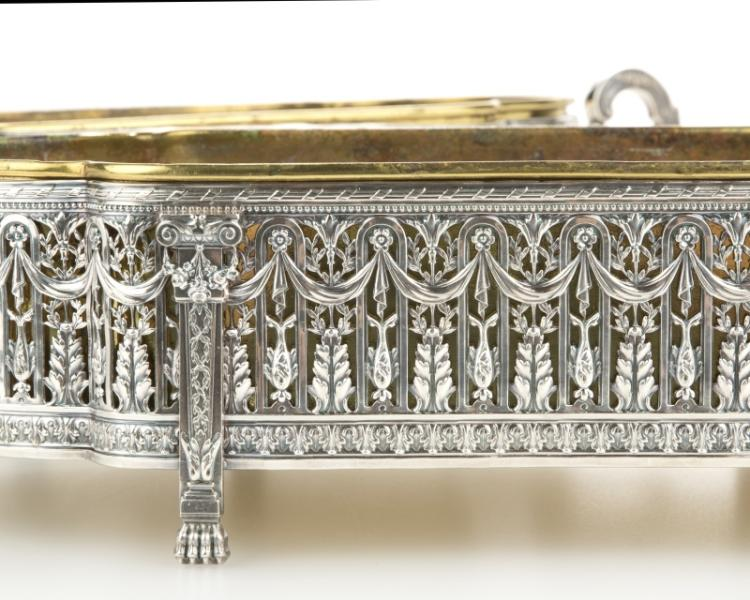 A pair of silver-plated table top jardinieres