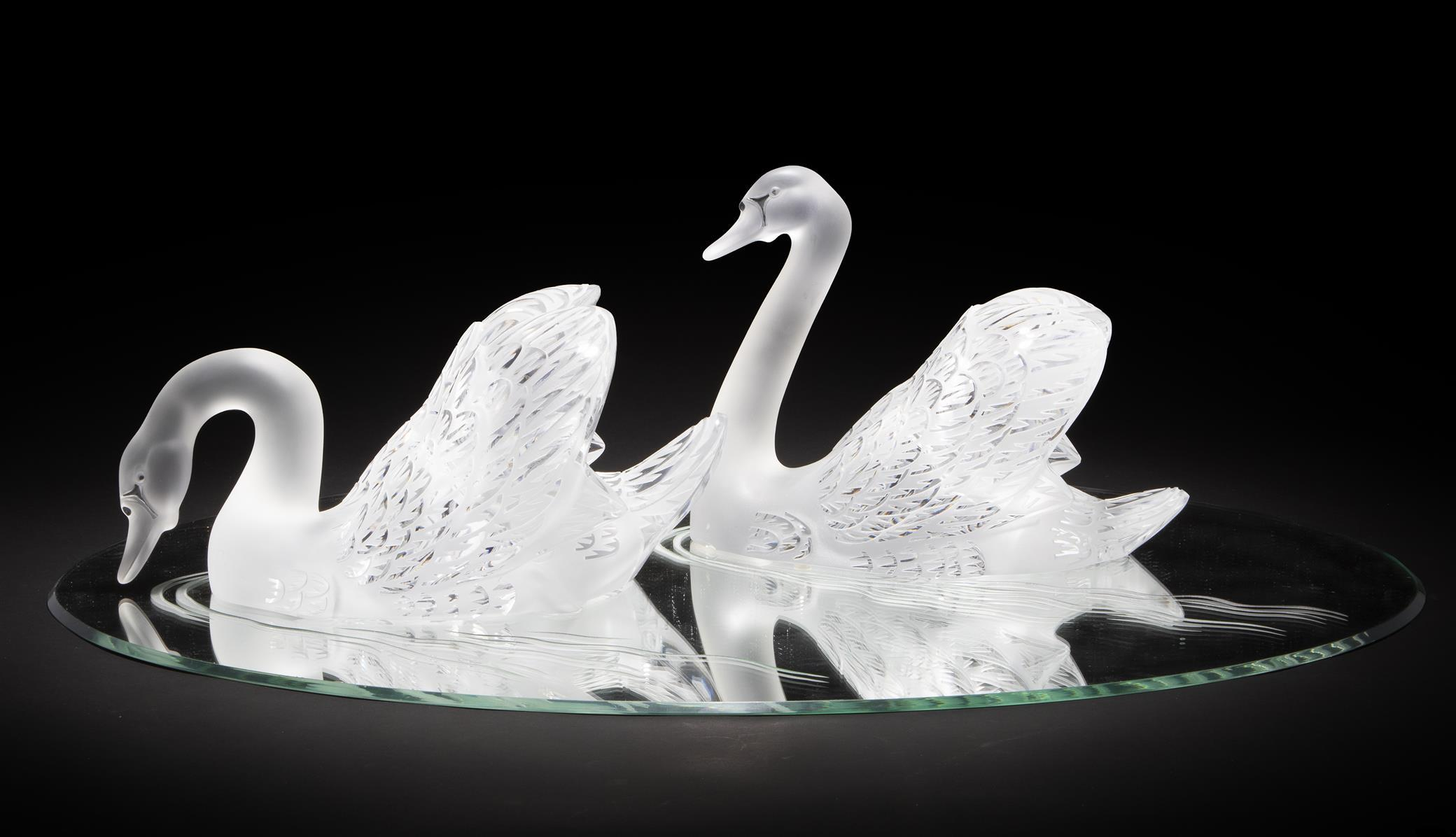 A pair of Lalique art glass swans