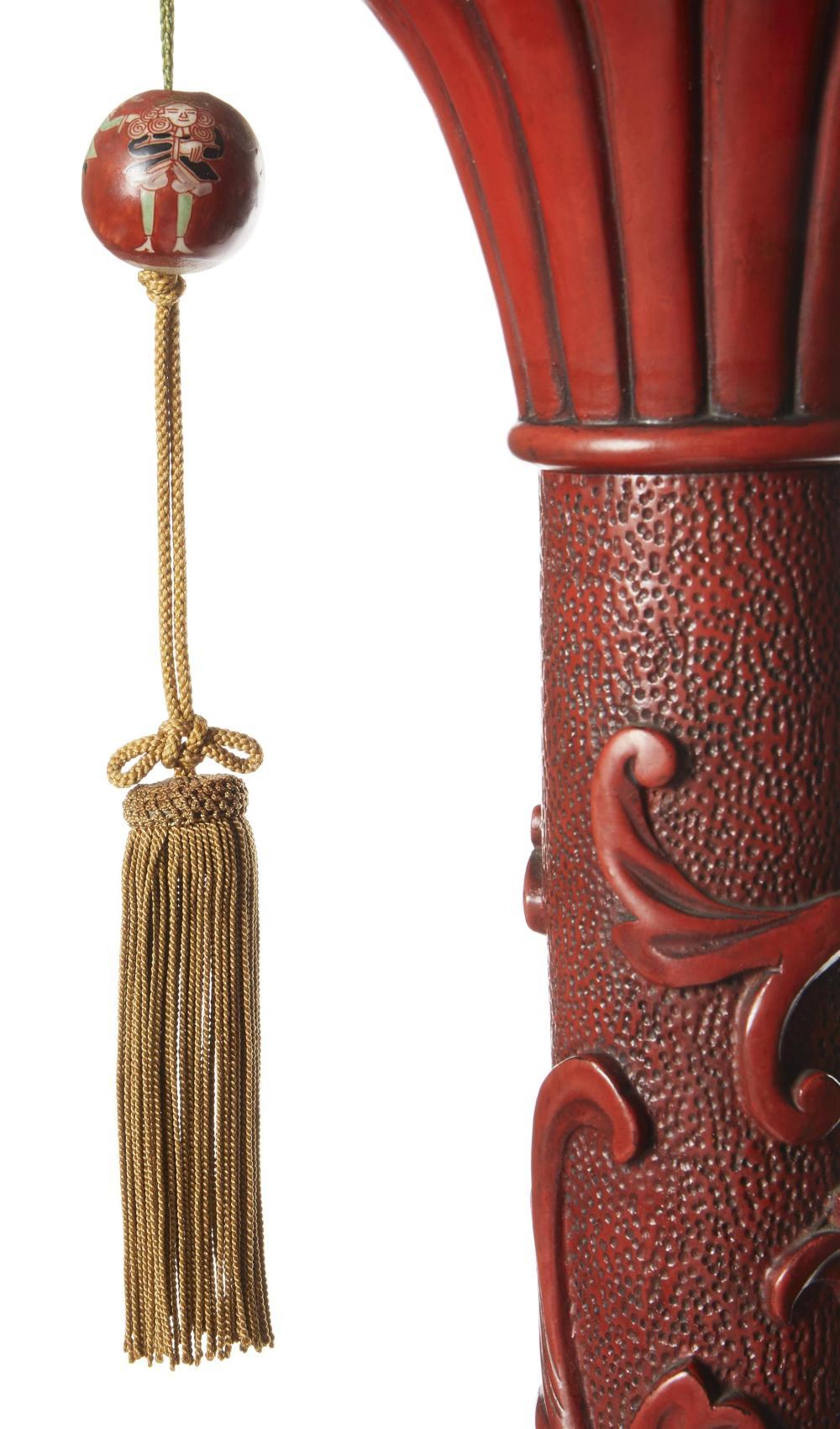 A Chinese cinnabar floor lamp