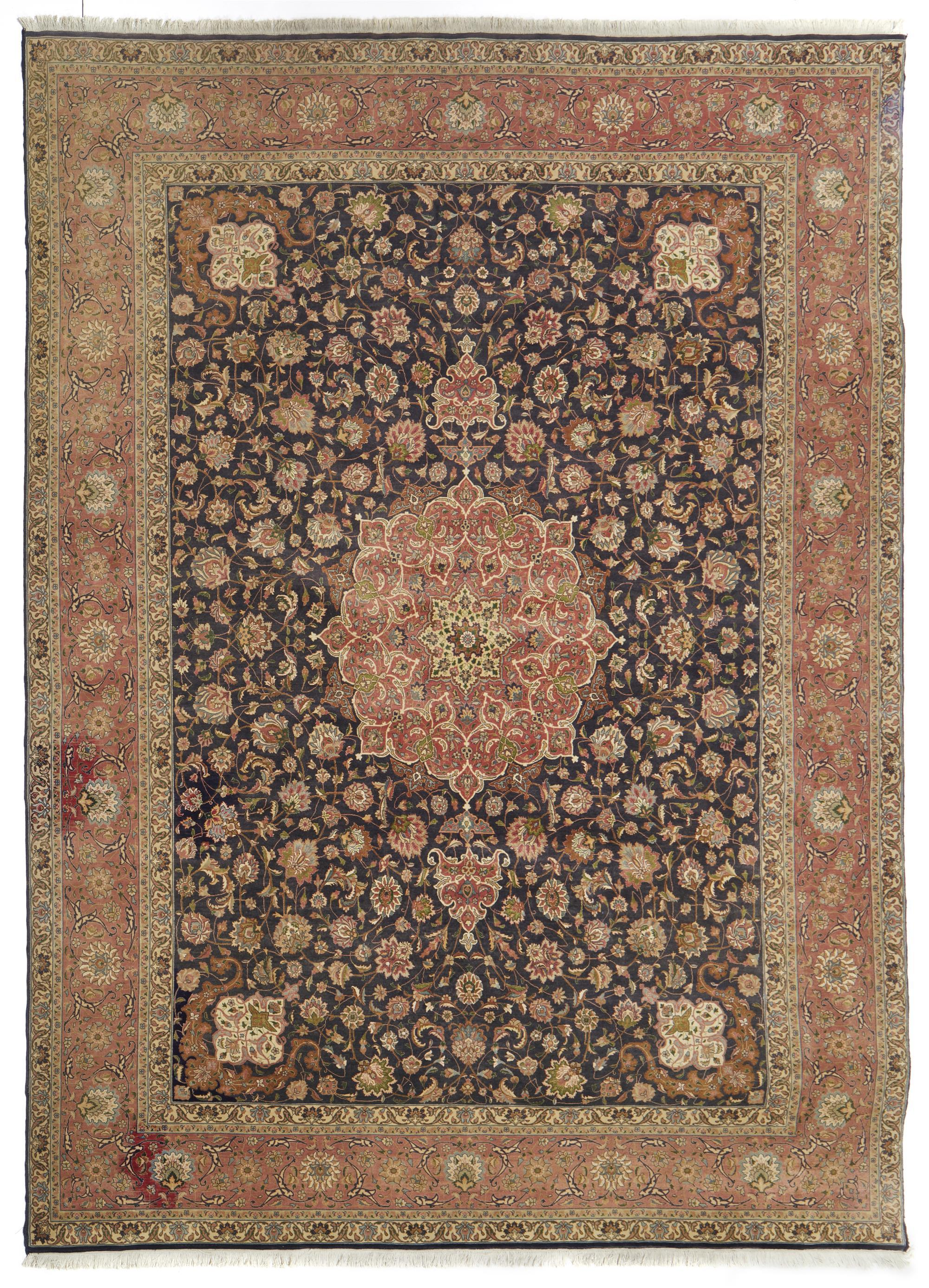 A Persian Tabriz area rug