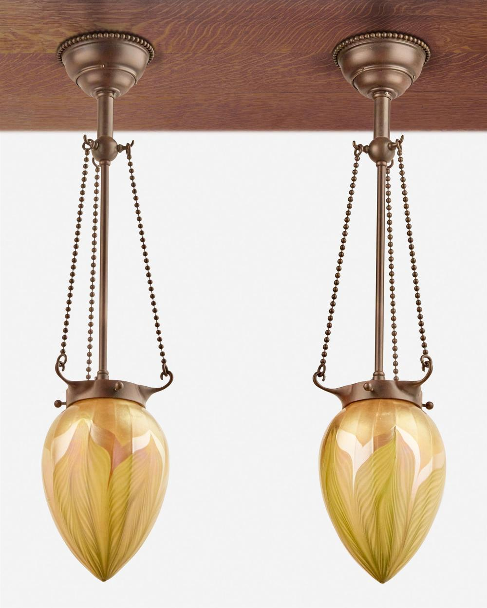 A pair of L.C. Tiffany Favrile glass pendant lights