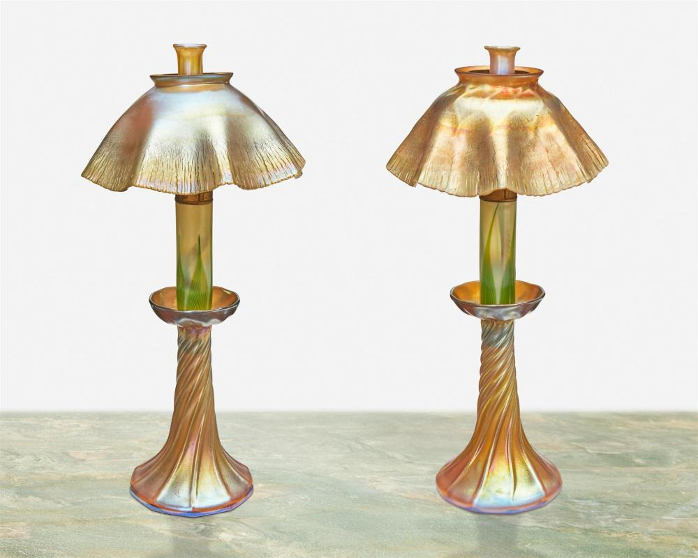 A near-pair of L.C. Tiffany Favrile glass candle lamps