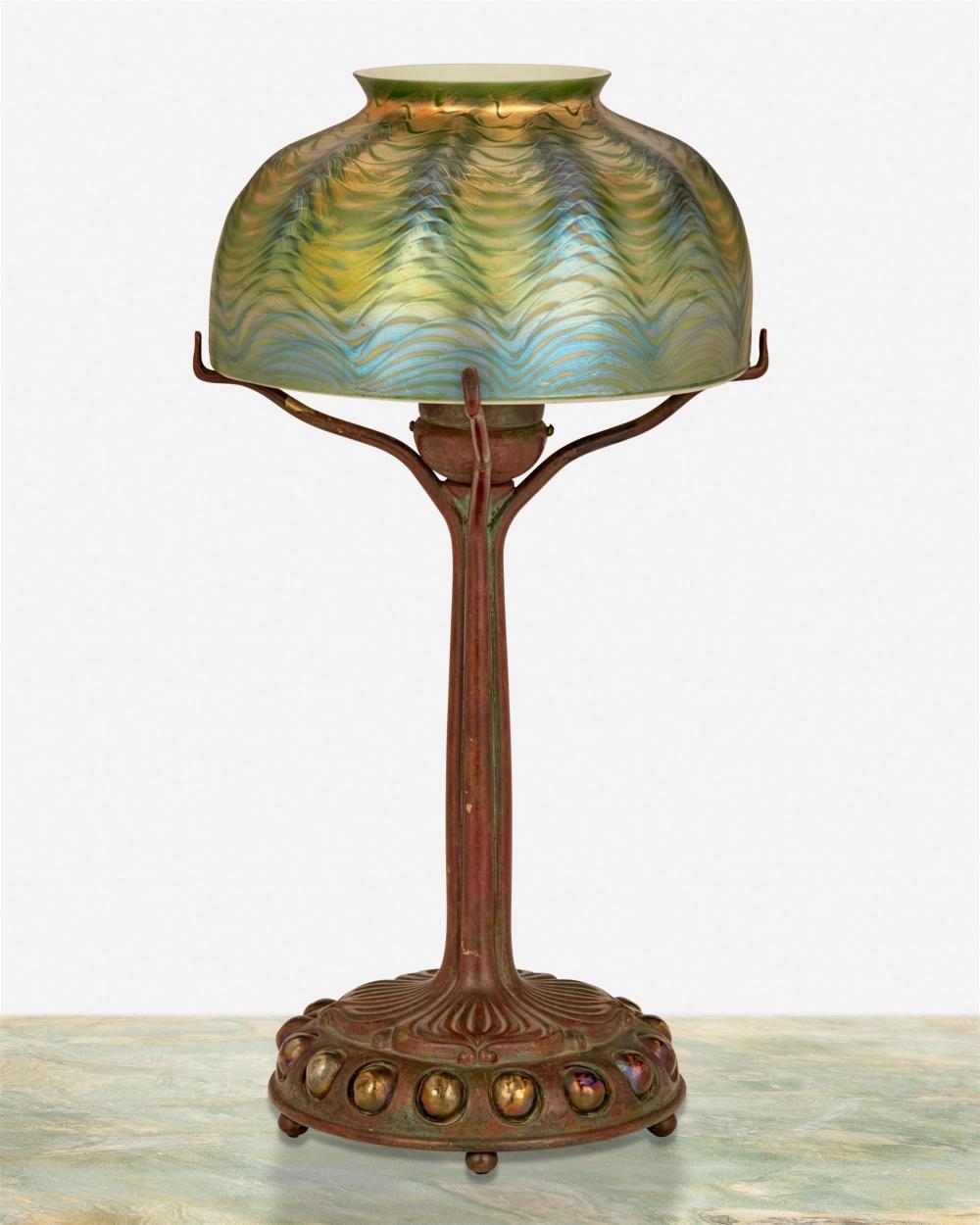 A Tiffany Studios bronze boudoir lamp with art glass shade