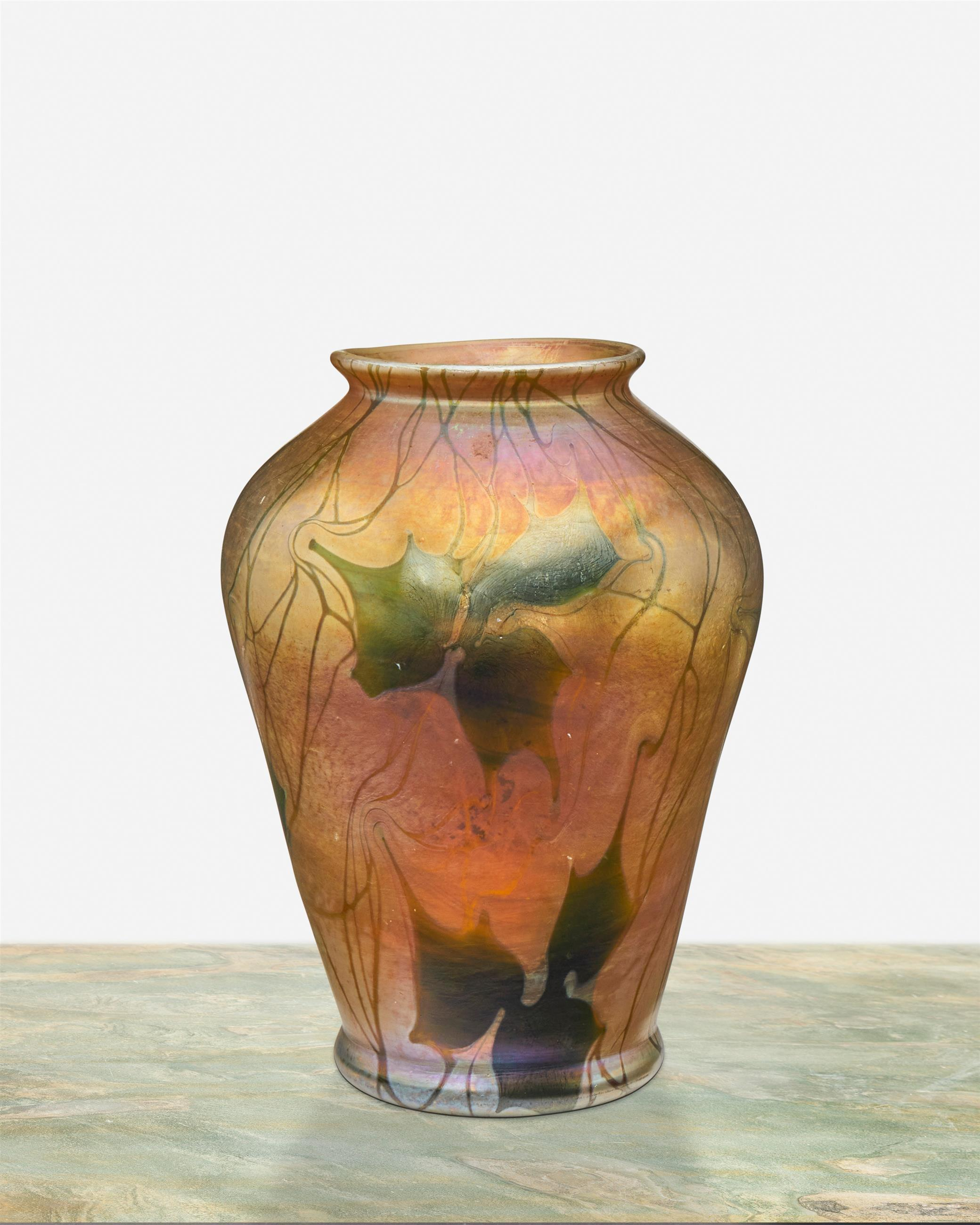 A L.C. Tiffany Favrile glass leaf and vine vase