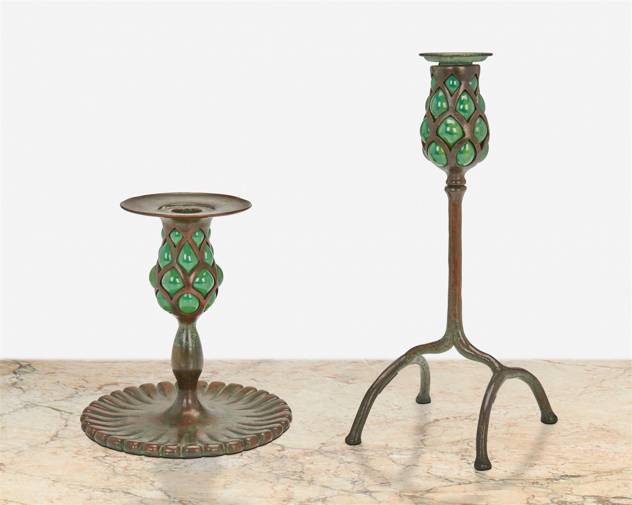 Two Tiffany Studios bronze and blown glass candlesticks
