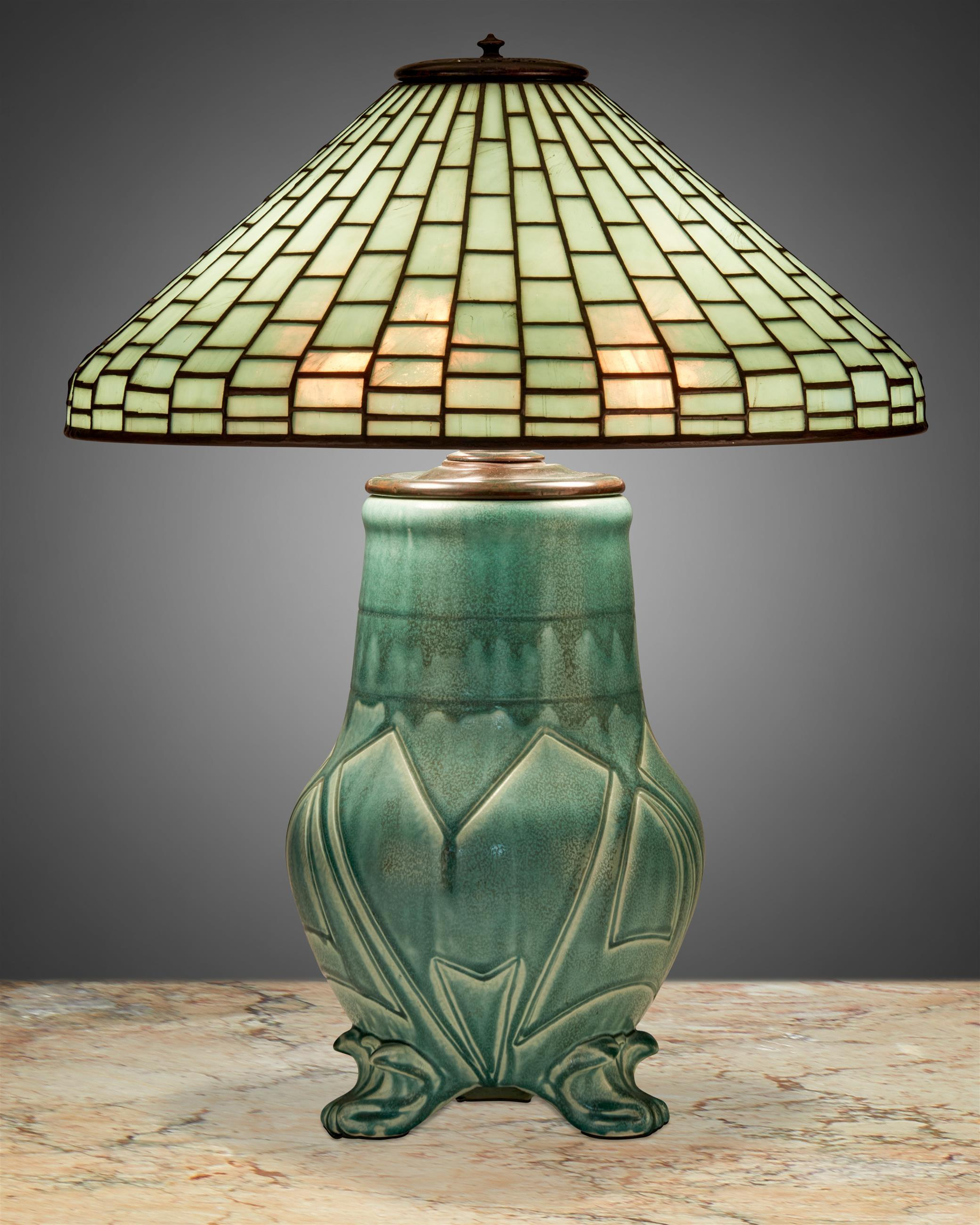 A Tiffany Studios leaded glass and Rookwood pottery table lamp