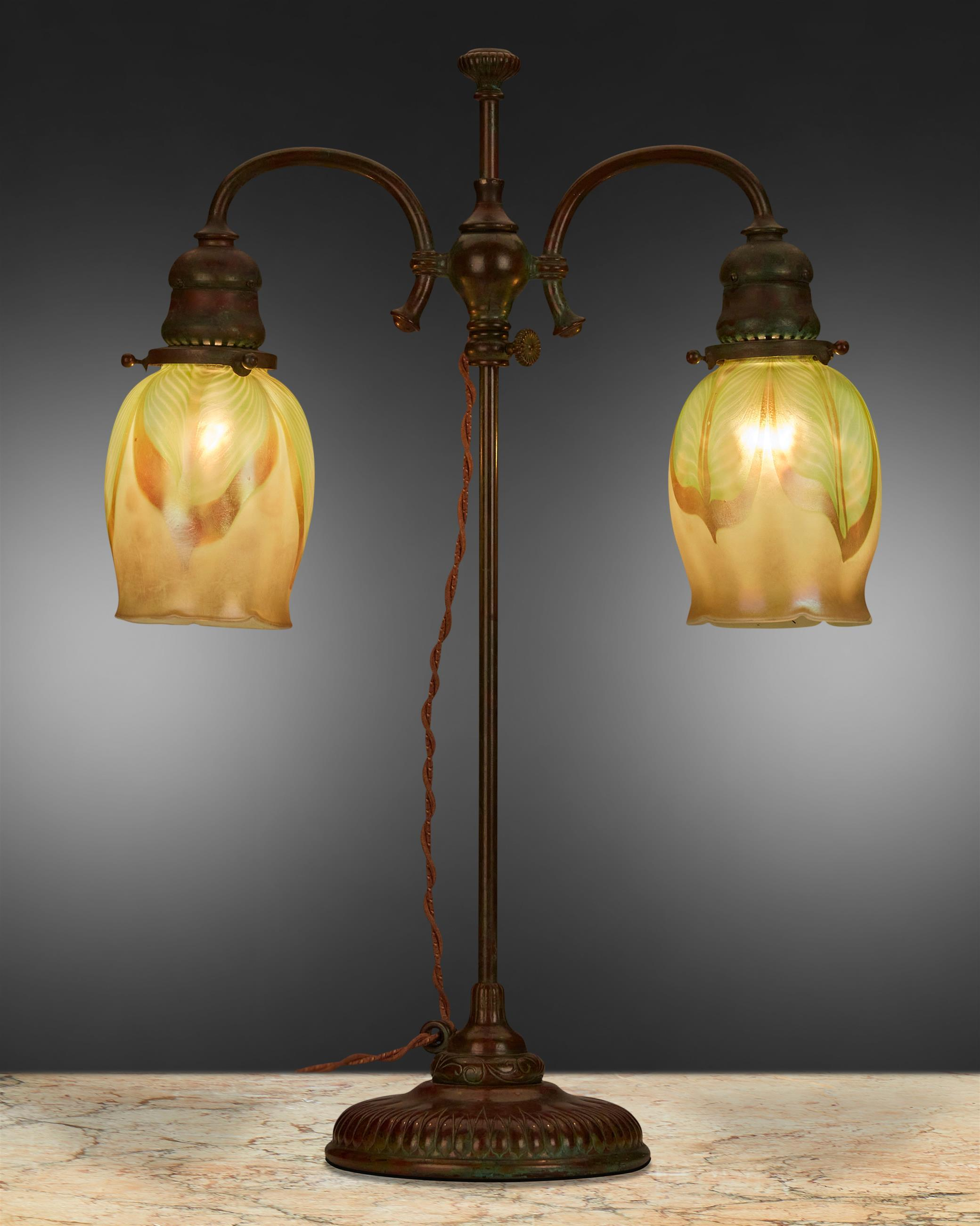 A Tiffany Studios double-arm table lamp