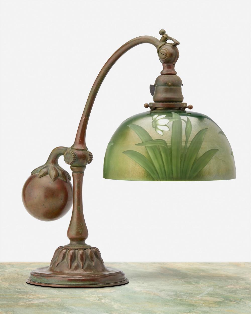 A Tiffany Studios counter-balance desk lamp with intaglio shade