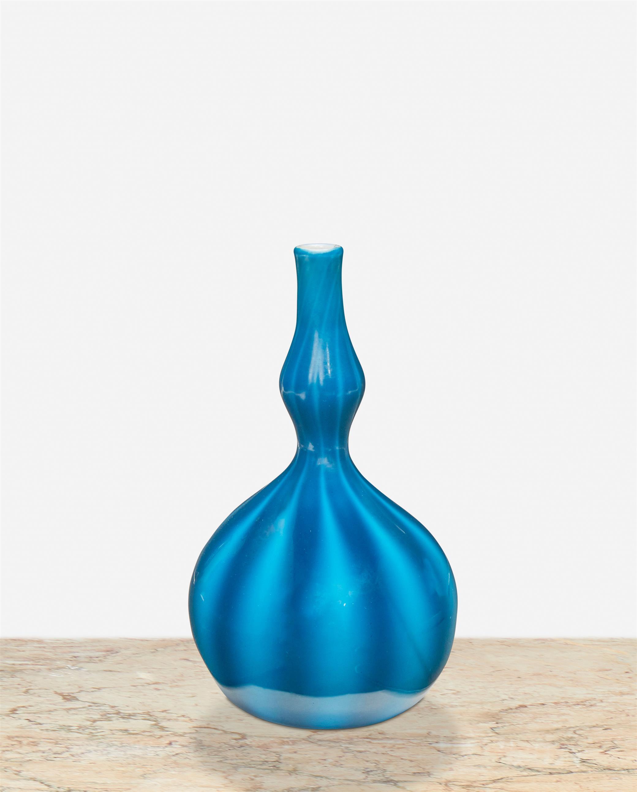 A blue L.C. Tiffany Favrile glass bud vase