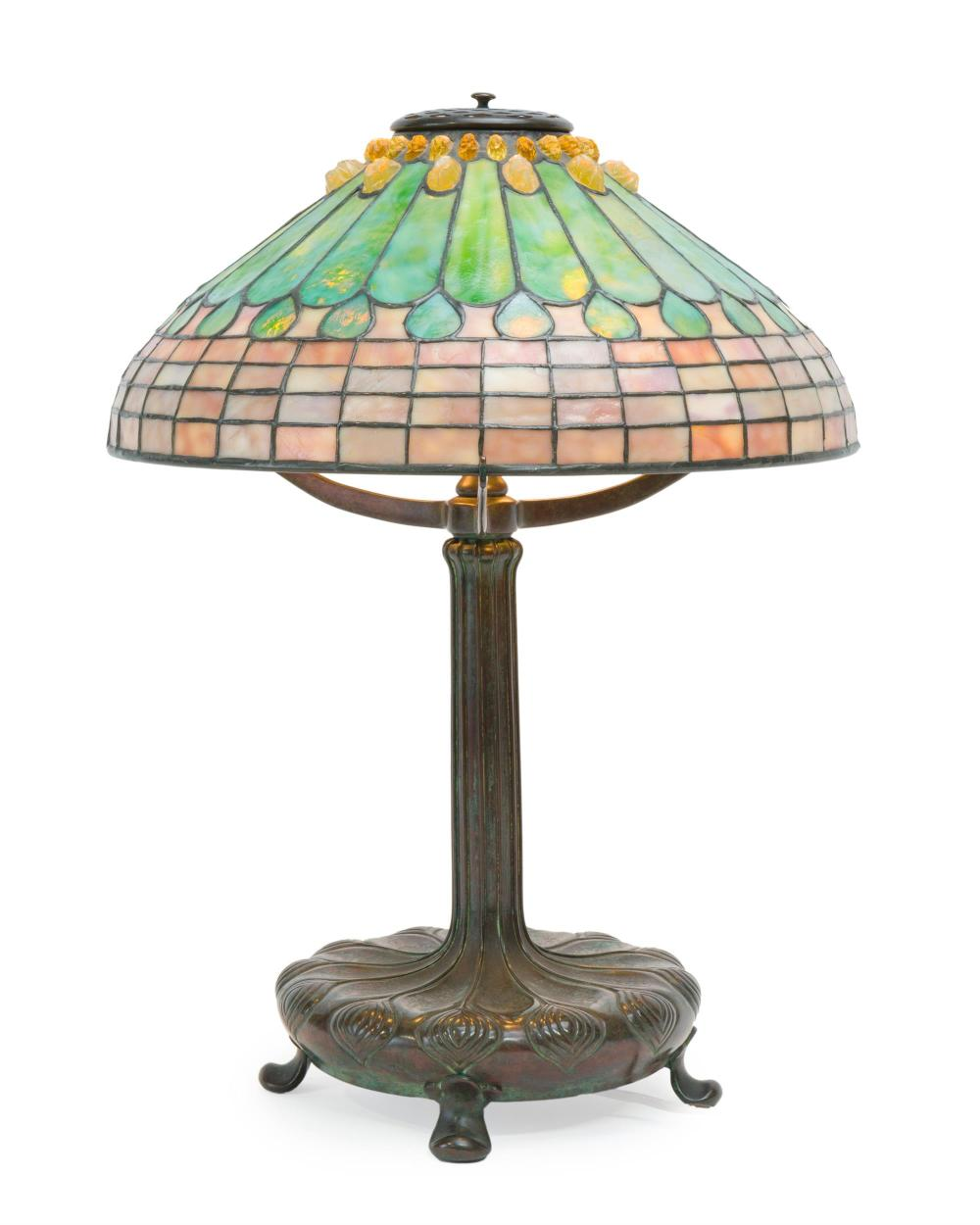 A Tiffany Studios leaded glass and bronze table lamp