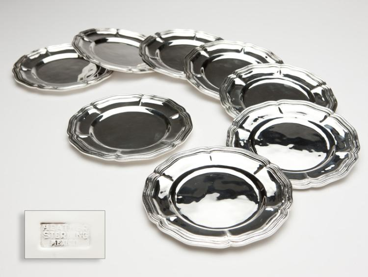 A set of eight sterling silver bread plates