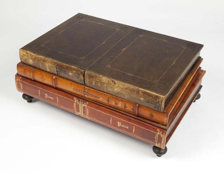 A leather bound book-form cocktail table
