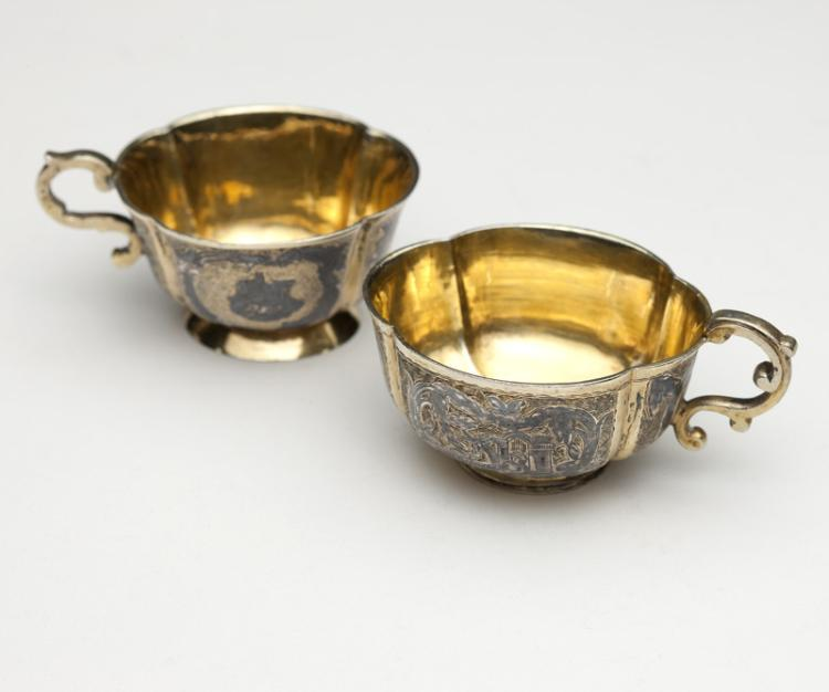 Two Russian silver-gilt and niello brandy cups