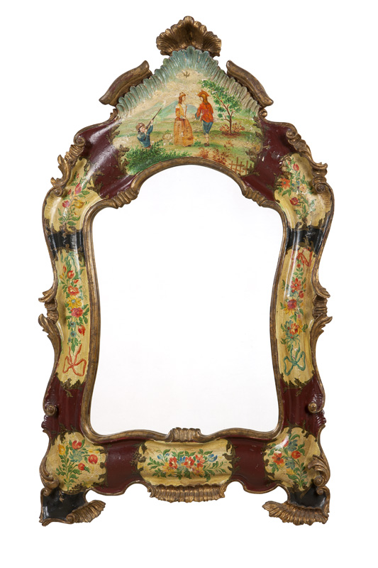 A Venetian carved and polychromed wall mirror