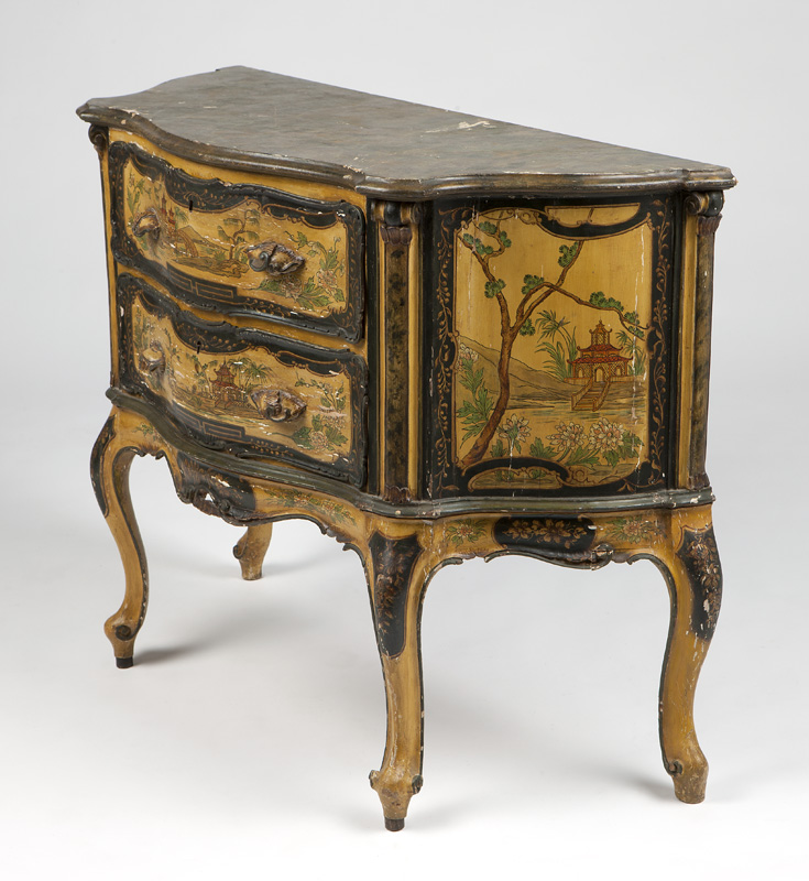 A Venetian-style carved and polychromed commode