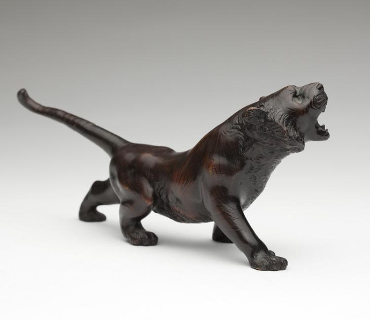 A Japanese patinated bronze tiger