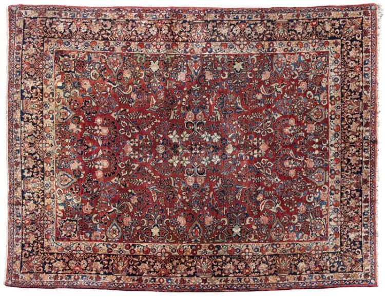 A large Persian Sarouk woolen rug