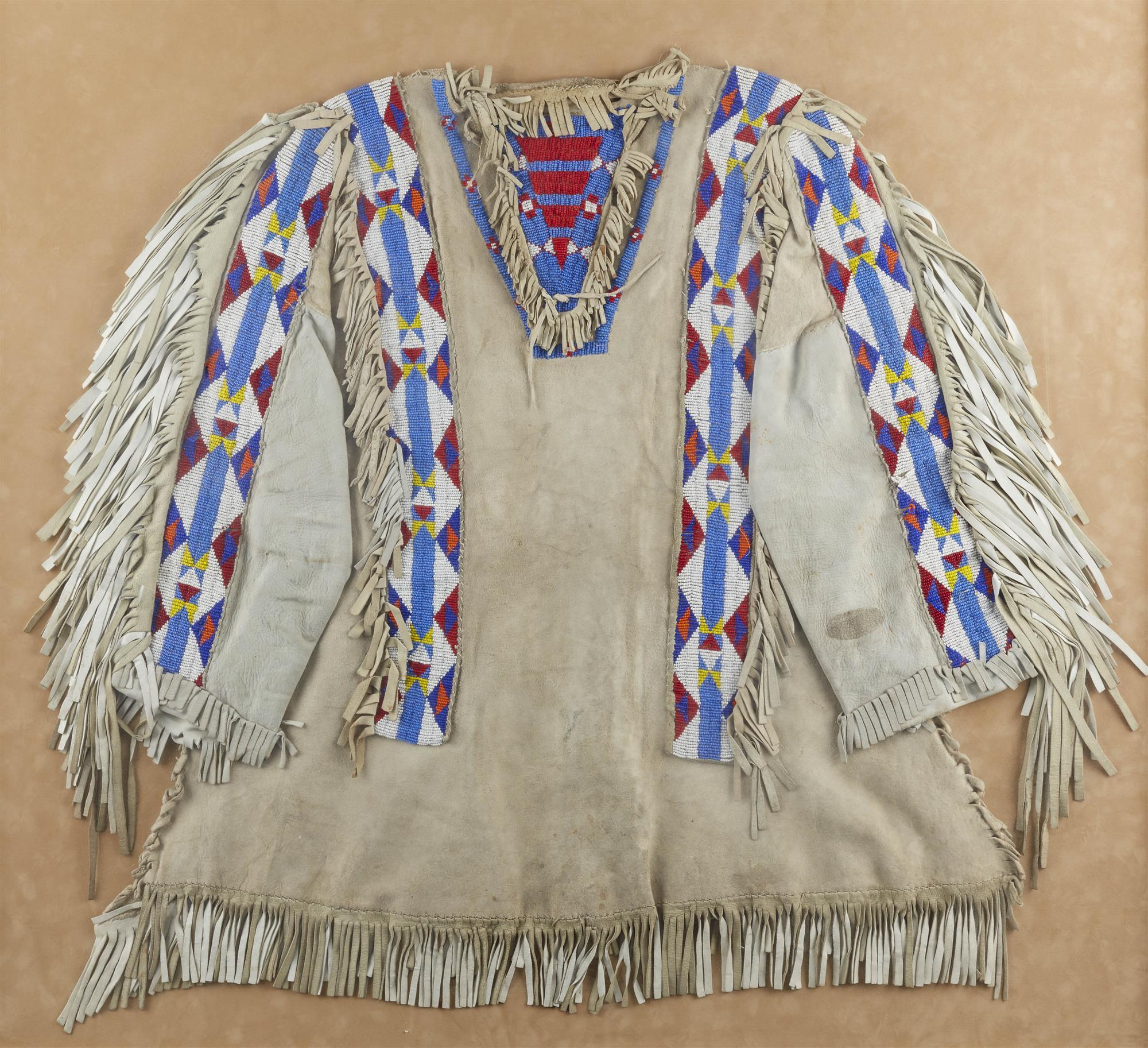 A framed Plains beaded war shirt