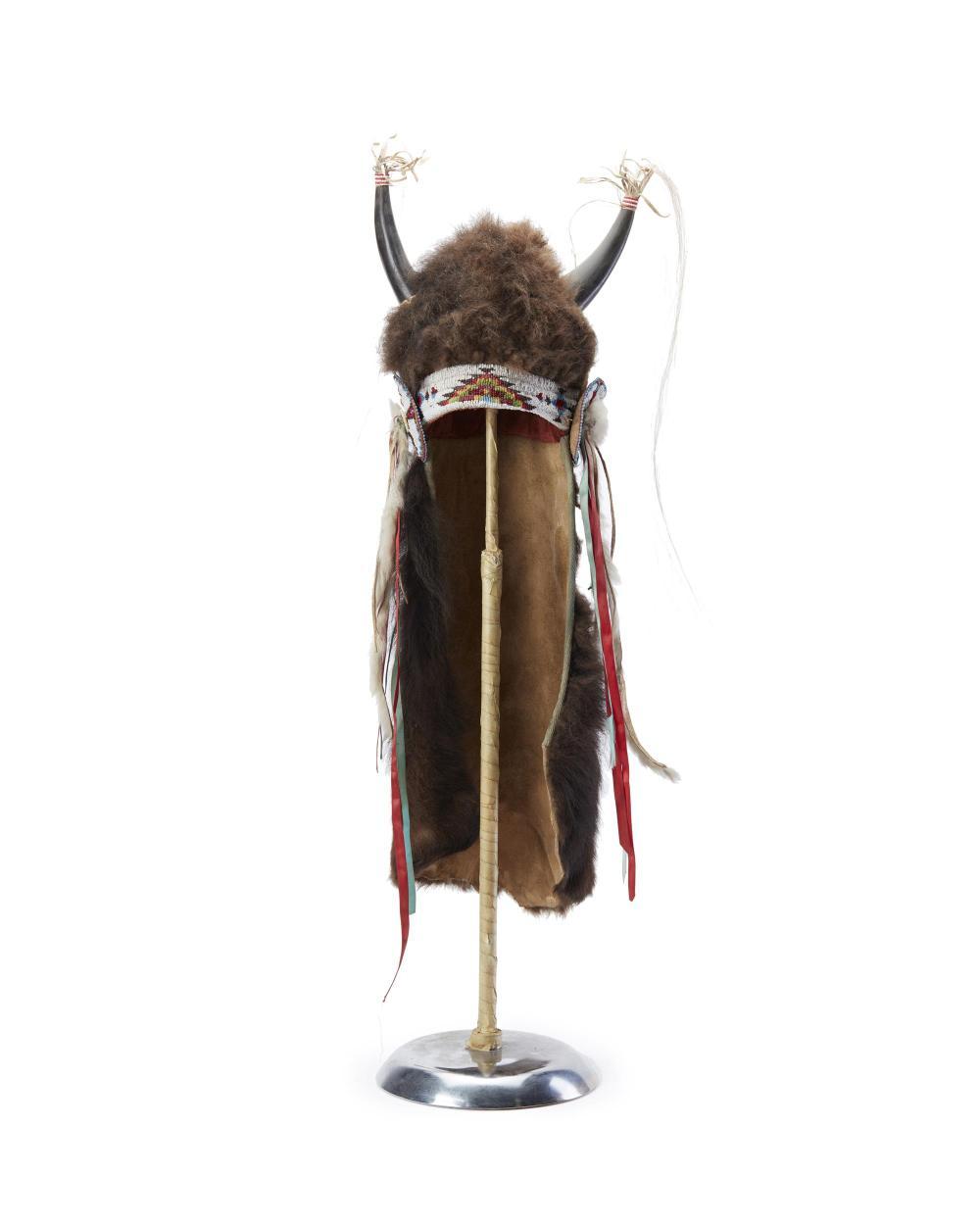 A beaded buffalo hide headdress with ermine strips