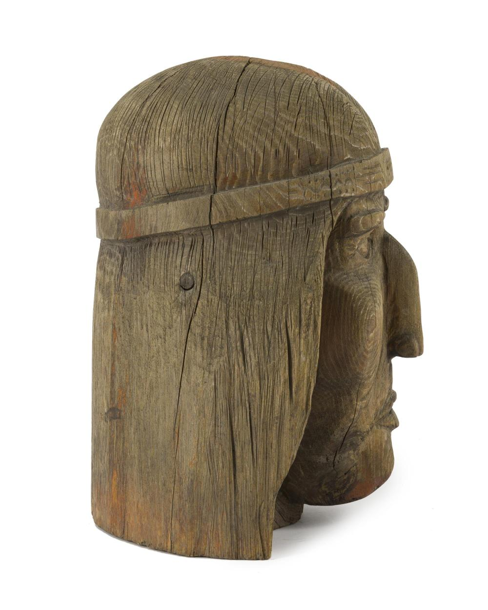 A carved wooden American Indian bust