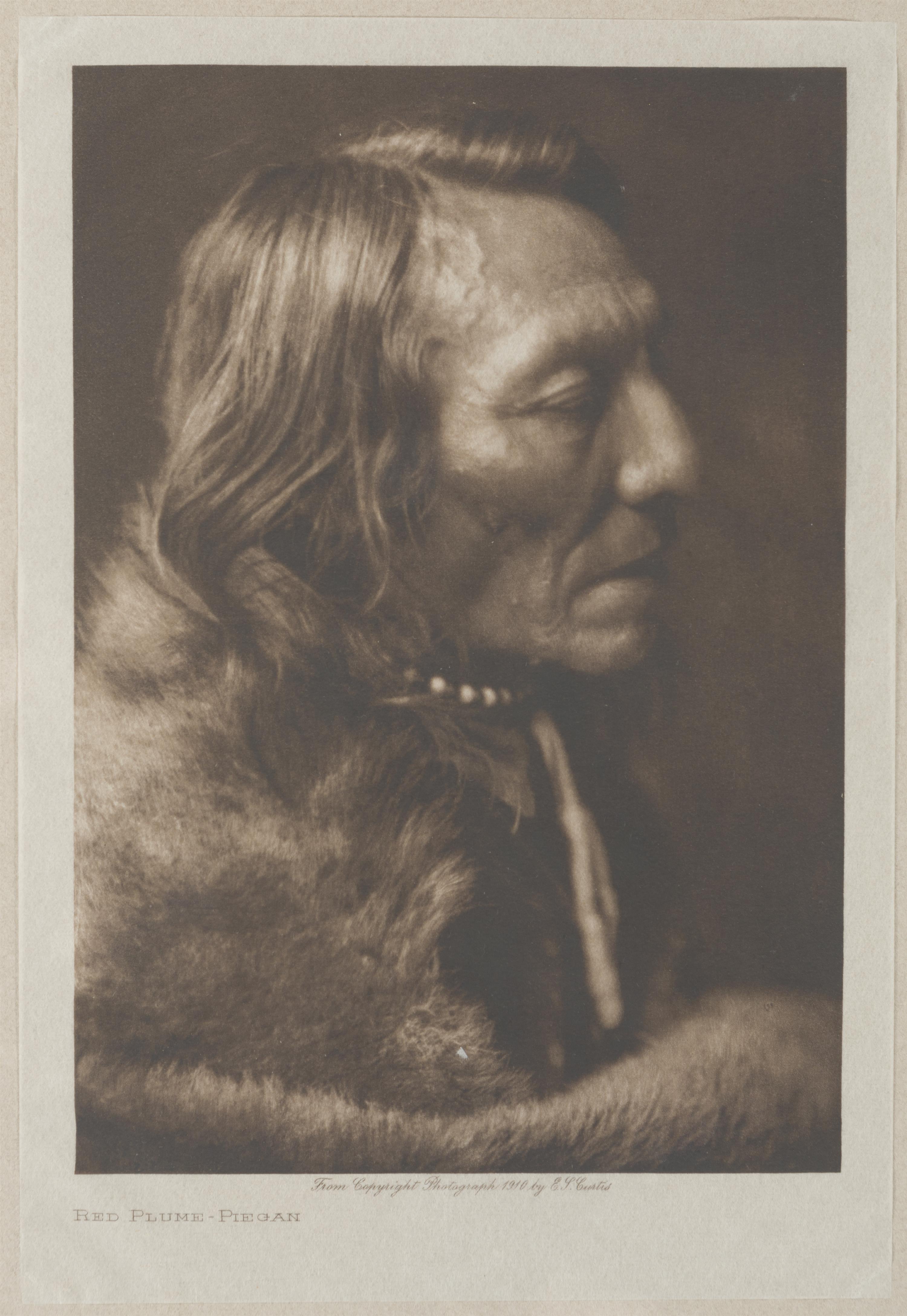 "Edward S. Curtis, (1868-1952 Los Angeles, CA), ""Red Plume - Piegan,"" 1910, Photogravure on paper laid to Van Gelder paper under glass,"