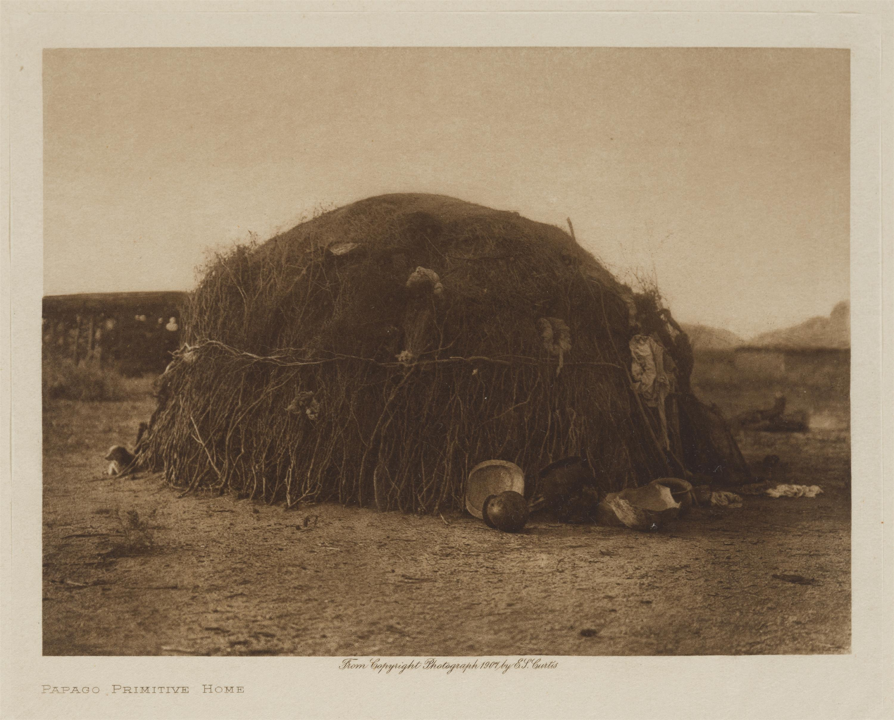 "Edward S. Curtis, (1868-1952 Los Angeles, CA), ""Papago Primitive Home,"" 1907, Photogravure on paper laid to Van Gelder paper under glas"