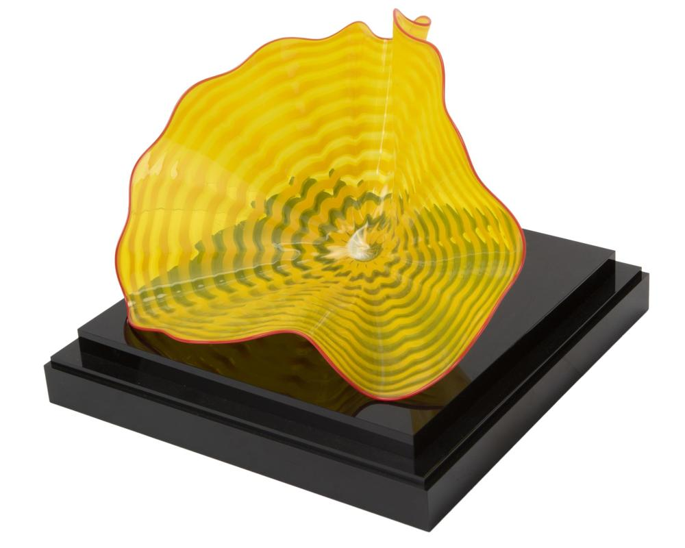 """Dale Chihuly, (b. 1941, American), """"Persian"""" glass bowl, Striped yellow glass with red lip on acrylic base, 8"""" H x 12.5"""" W x 9"""" D"""
