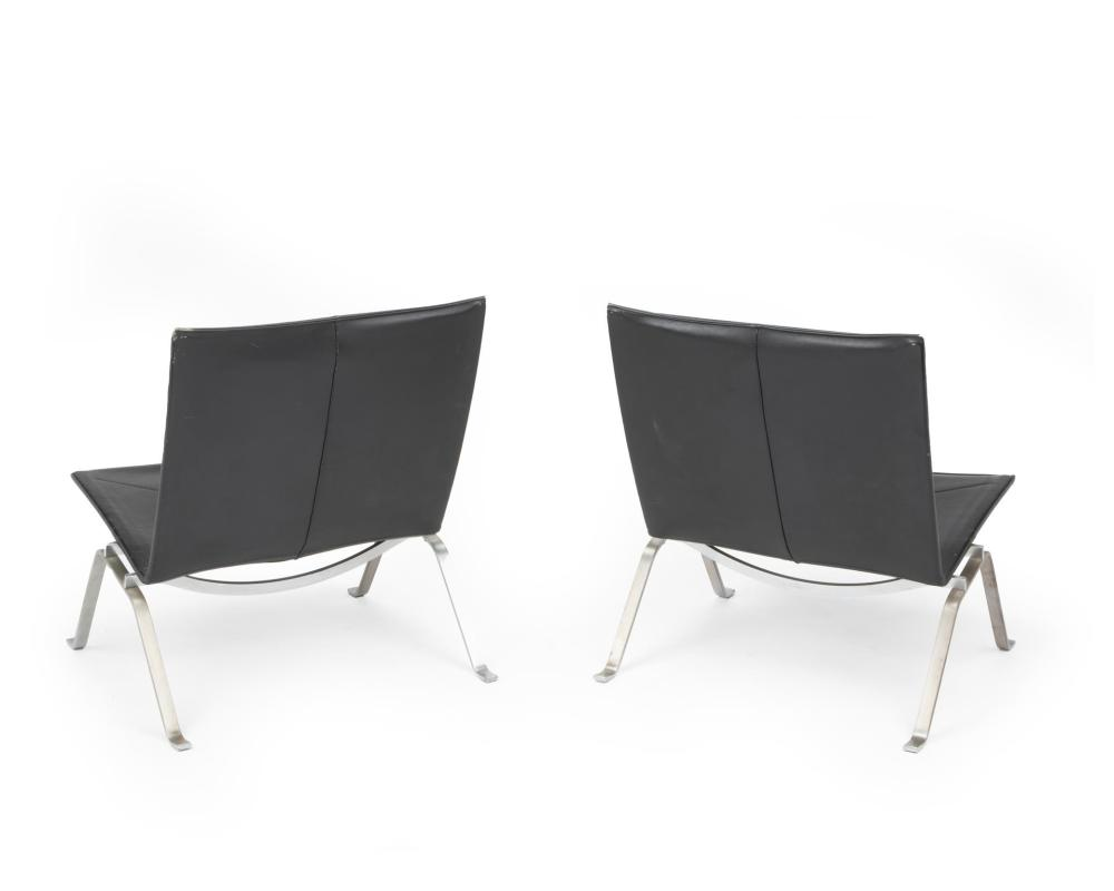 Poul Kjaerholm, (1929-1980, Danish), A pair of PK22 side chairs, Chromed metal and black leather, Each approximately: 27.5