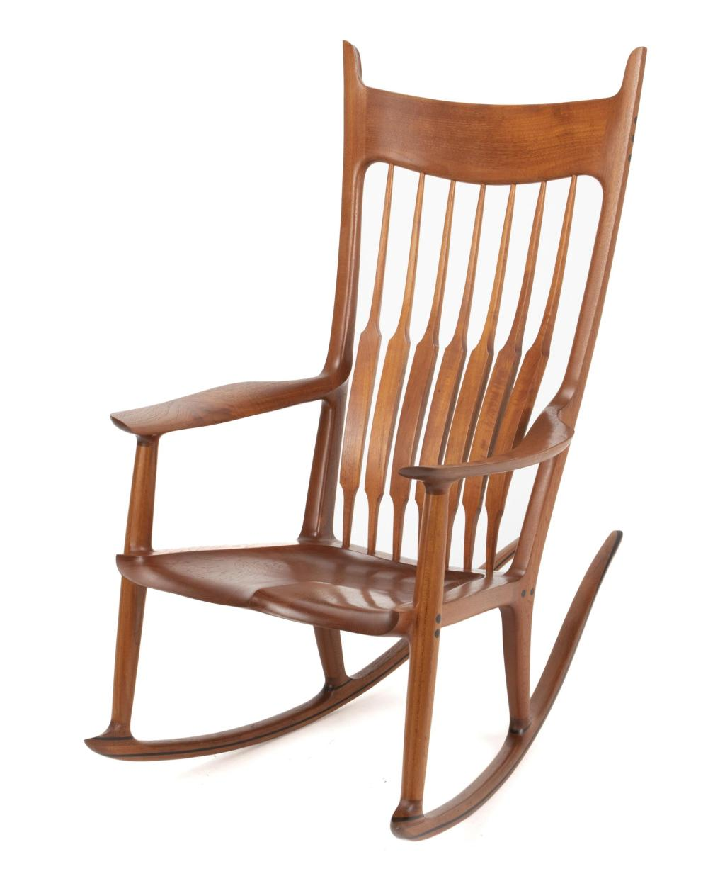 "Sam Maloof, (1916-2009, American), Rocking chair, Teak with ebonized plugs and decorative banding, 45"" H x 46"" W x 26.125"" D"