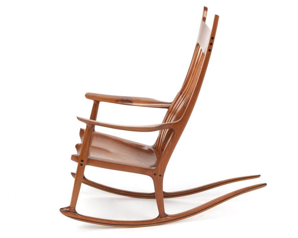 Sam Maloof, (1916-2009, American), Rocking chair, Teak with ebonized plugs and decorative banding, 45