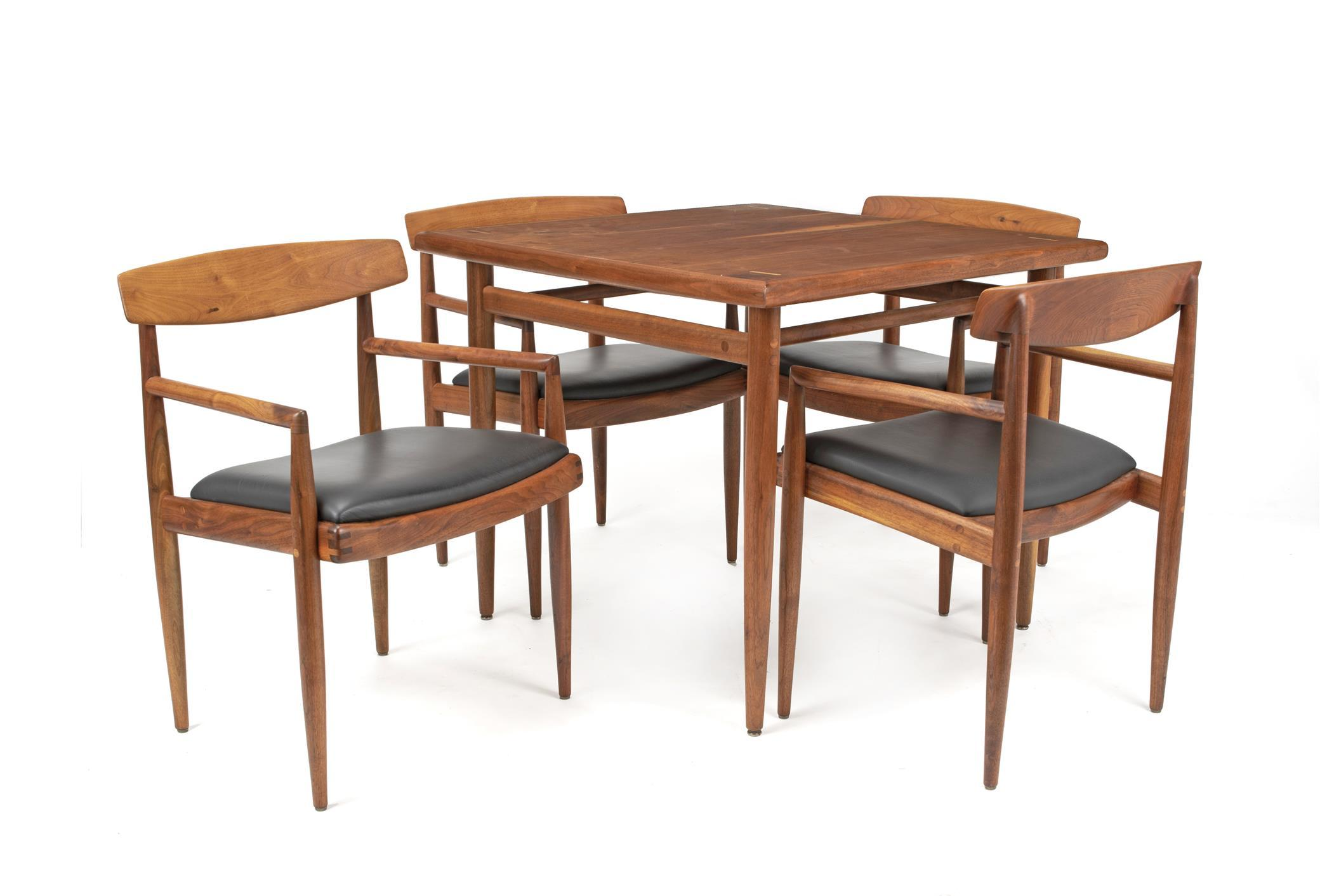 "Sam Maloof, (1916-2009, American), Game table and low-back chairs, 5 pieces, Walnut and black leather, Table: 29.625"" H x 35.125"" W x 3"