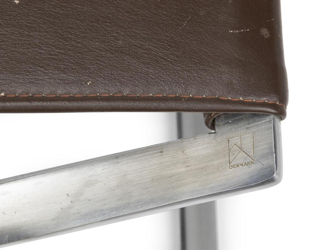 Poul Kjaerholm, (1929-1980, Danish), PK91 folding footstool, Chromed metal and sienna brown leather, 14.325