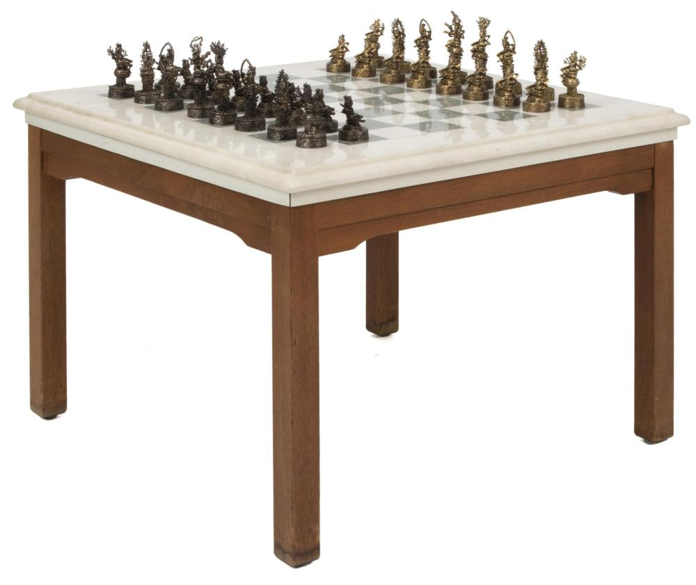 """Sascha Brastoff, (1918-1993, American), A """"Shangri-la"""" pattern chess set on marble and wood base, Bronzed and gilt-colored metal, marbl"""