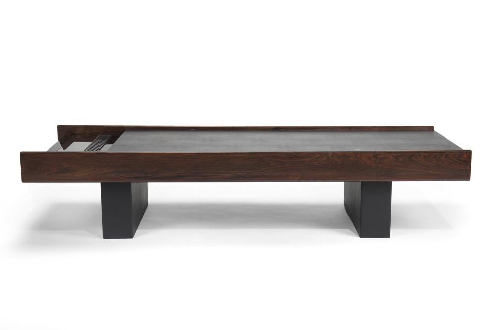 John Scott, (fl. late 20th/early 21st Century, American), Custom designed low table in dark walnut and textured black vinyl with Bang &