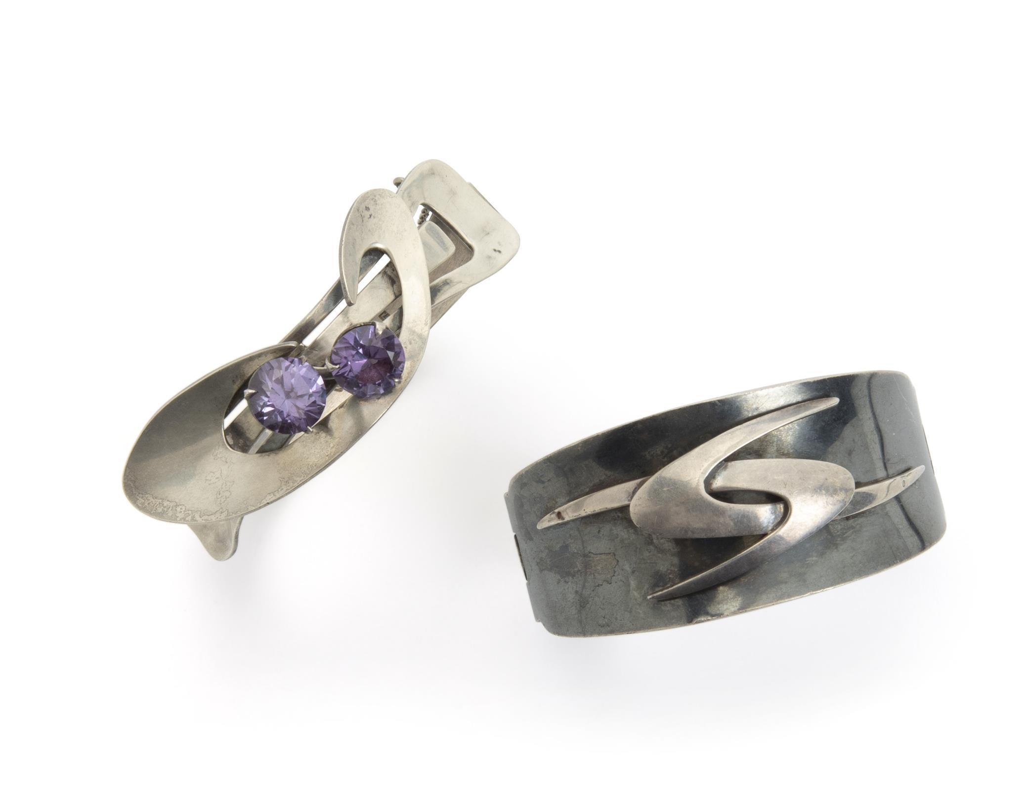 Two Enrique Ledesma silver cuff bracelets