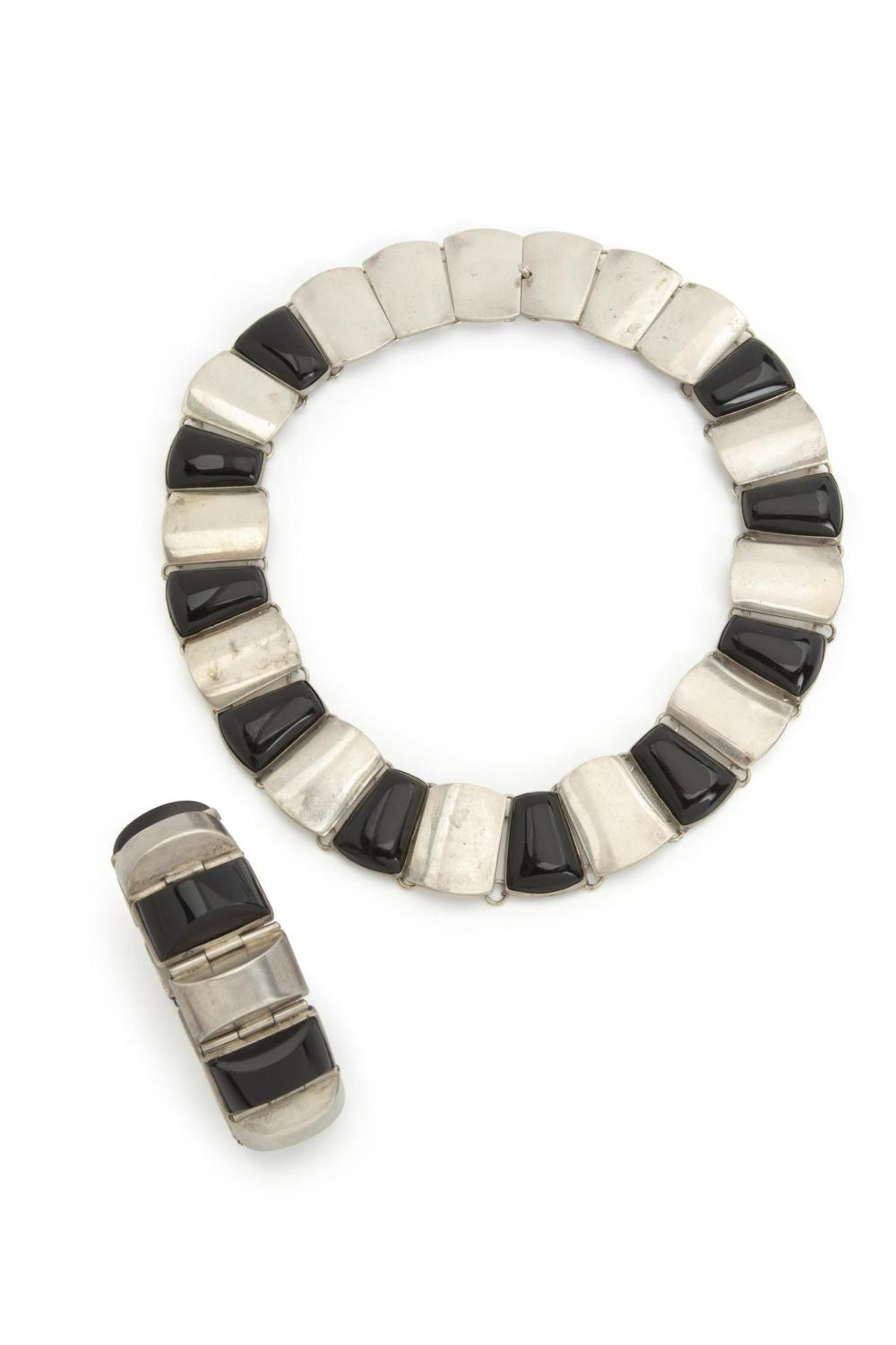 An assembled set of Antonio Pineda silver and obsidian jewelry