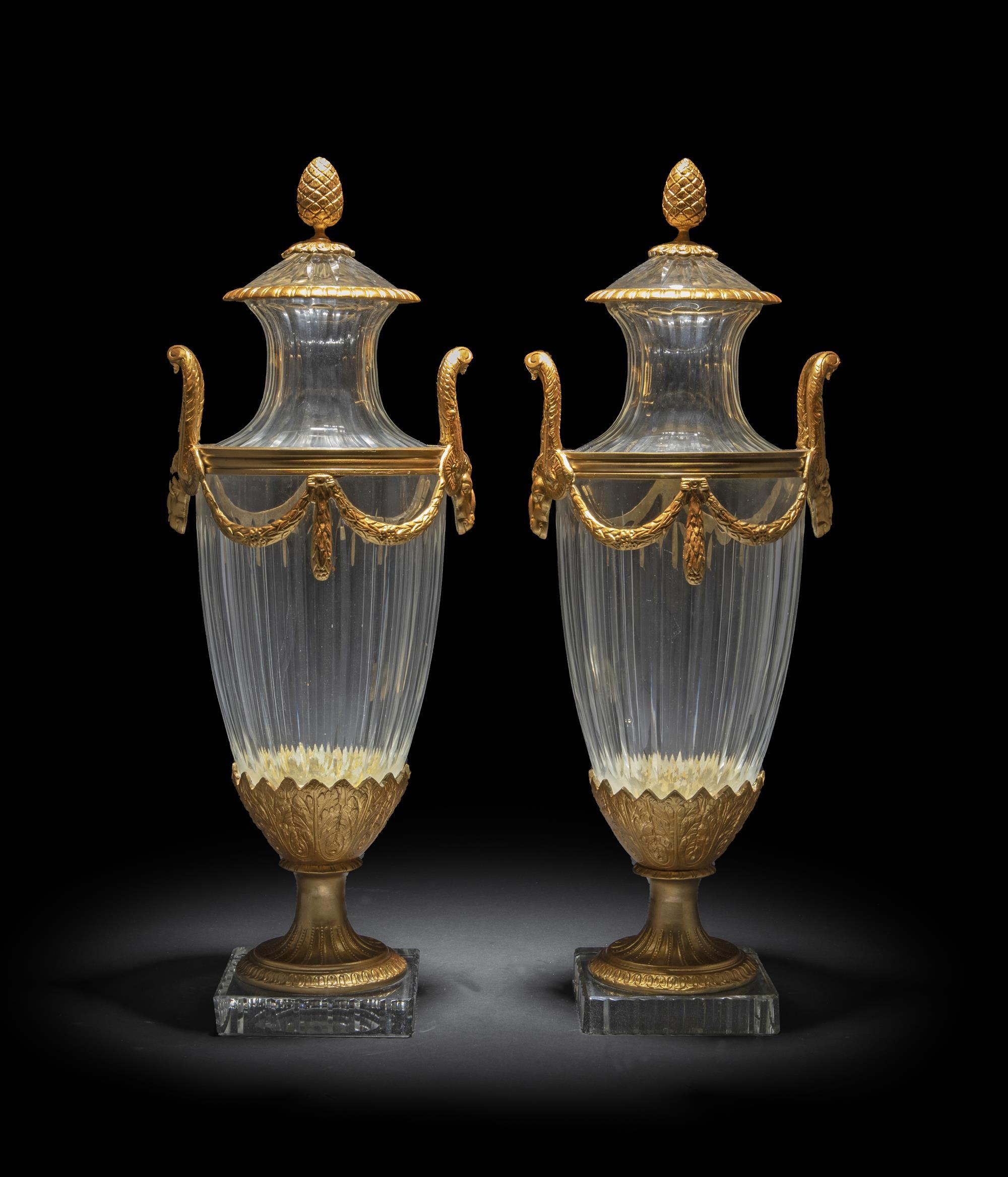 A pair of French crystal and bronze vases