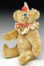 CIRCA 1912 VERY RARE CLOWN STYLE STEIFF RATTLE BEAR WITH BUTTON.