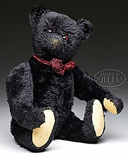 INCREDIBLY RARE, HISTORICALLY IMPORTANT, AND ASTONISHINGLY COLLECTIBLE BLACK STEIFF TITANIC MOURNING BEAR WITH BUTTON.