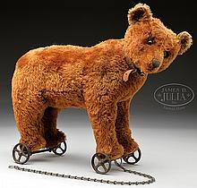 EARLY CINNAMON BROWN CENTER SEAMED STEIFF BEAR ON WHEELS.