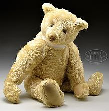 SPECTACULAR AND IMPRESSIVE MID 1920s ERA WHITE STEIFF BEAR WITH BUTTON.