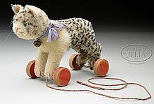 PRECIOUS 1930s ERA STEIFF CAT ON RED WOODEN WHEELS.