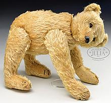ASTONISHINGLY RARE AND HISTORICALLY IMPORTANT ORIGINAL STEIFF ROD BEAR WITH ELEPHANT BUTTON.