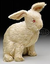 UNUSUAL AND HIGHLY COLLECTIBLE EARLY WHITE STEIFF RABBIT WITH BUTTON.