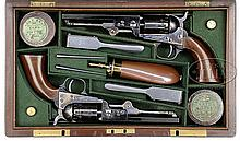 EXTREMELY RARE CASED PAIR OF COLT MODEL 1849 POCKET PERCUSSION REVOLVERS MARKED FOR THE LONDON MARKET.