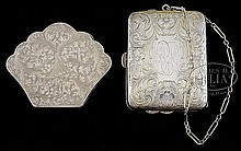 TWO SILVER COMPACTS.