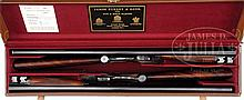 WONDERFUL PAIR OF SELF-OPENING SINGLE TRIGGER SIDELOCK EJECTOR GAME SHOTGUNS BY JAMES PURDEY WITH MAGNIFICENT GOLD INLAID BIRDS AND METICULOUS SCROLL BY MARCUS HUNT, WITH CASE.