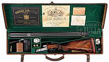CHARLES LANCASTER B GRADE BOXLOCK DOUBLE RIFLE WITH CASE AND ACCESSORIES.