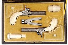 SHOWY PAIR OF HIGH ORIGINAL CONDITION IVORY STOCKED SCREW BARREL BOXLOCK PERCUSSION MUFF PISTOLS WITH FOLDING TRIGGERS IN THEIR FINE ROSEWOOD VENEERED FRENCH FITTED CASE, WITH ACCESSORIES.